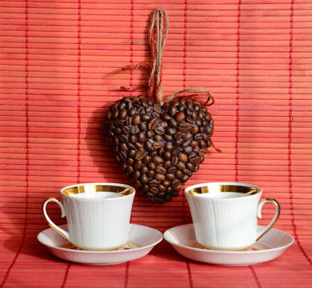 valentine day cup of coffee: Heart of coffee beans and coffee cup (Valentine. Valentines Day)