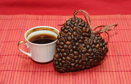 valentine day cup of coffee: Heart of coffee beans and  cup (Valentine. Valentines Day) Stock Photo