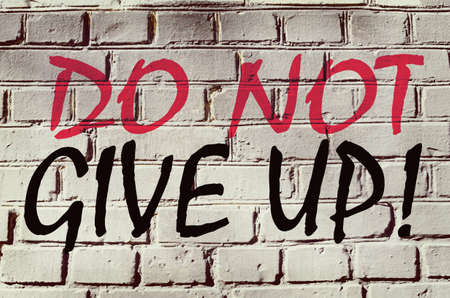 not give: Wall with graffiti that says Do not give up (abstract background, vintage, grunge - concept)