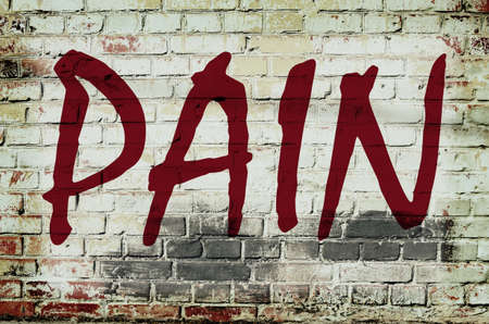 the hangover: Wall with graffiti that says Pain (abstract background, vintage, grunge - concept)