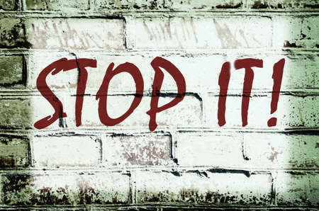 rising prices: Wall with graffiti that says Stop it! (abstract background, vintage, grunge - concept)