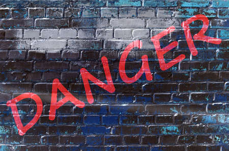 rapist: Wall with graffiti that says Danger (abstract background, vintage, grunge - concept) Stock Photo