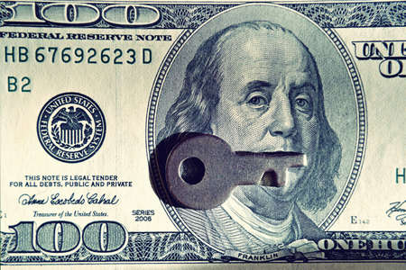 Key and dollar bill (corruption, lobbying, financial secrecy - concept). Vintage effect.