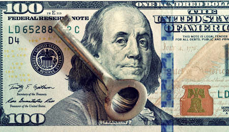 lobbying: Key and dollars (corruption, lobbying, financial secrecy, loans - concept). Vintage effect. Stock Photo