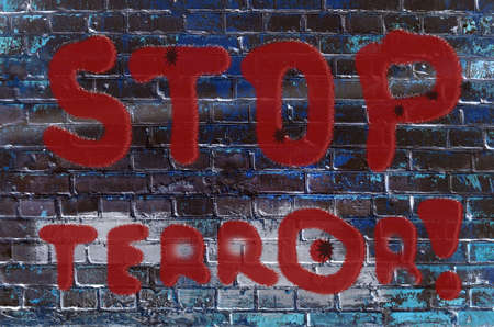 threat: The inscription on the wall of graffiti with the slogan Stop terrorism (acts of terrorism, threat - concept)