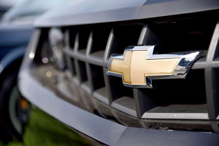 chevrolet: Kyiv, Ukraine – Apr 23, 2016: The logo of Chevrolet close up. Chevrolet is a trademark of General Motors (GM).