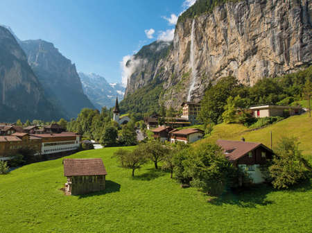 The beautiful landscape of the town Lauterbrunnen in the canyon of the Swiss Alps in the sun rays. Switzerland, Europe