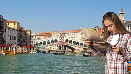 Girl with map in hand in Venice near the bridge lovers, Italy, Europe