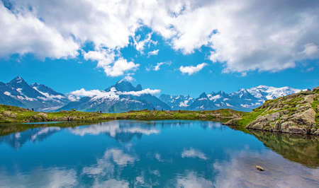 Fantastic landscape with lake on the background of Mont Blanc, French Alps, Europe. (Harmony, tourism, meditation background - concept) Standard-Bild