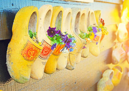 The traditional national wooden shoes  Klomp like  flowerpots with flowers in vintage style Stock Photo