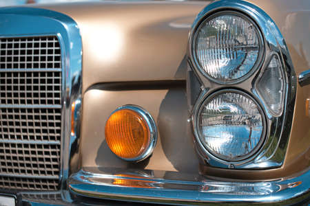 collectibles: The headlights of vintage car close-up