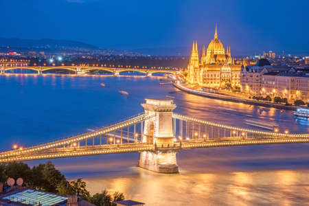 neogothic: The picturesque view of of the Parliament and the bridge over the Danube in Budapest, Hungary, Europe in evening on lamps light