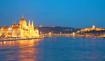 neogothic: The picturesque landscape of the Parliament and the bridge over the Danube in Budapest, Hungary, Europe