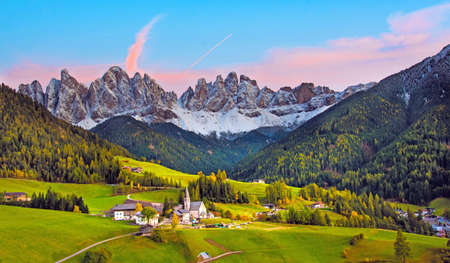 Incredible landscape with the church in the valley of Santa Magdalena, Italy, Europe, Dolomites at dawn