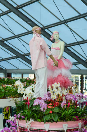 mannequins boy and girl in flowers (love, couple, family, marriage, February 14, Valentines Day - concept)