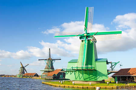 zaan: The charming landscape of ponds and windmills in Zaanse Schans, Holland, Europe against the sky