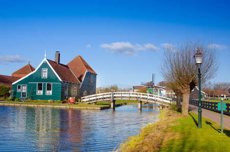 Mystical landscape with a bridge across the river and the scene in Zaanse Schans, Holland, Europe.