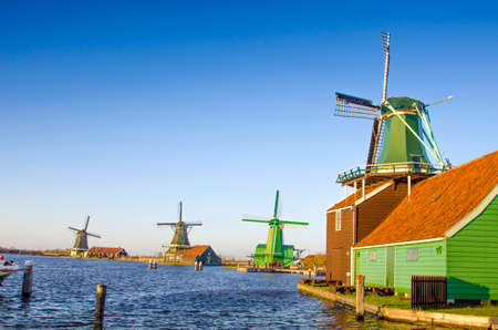 zaan: Romantic scenes with air mill in Zaanse Schans, Holland, Europe, at sunset. Stock Photo