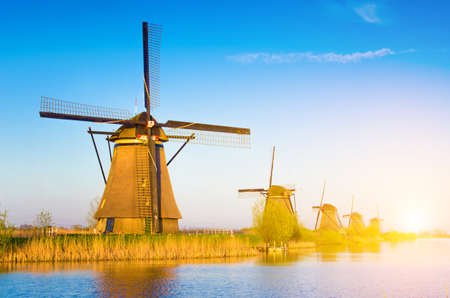 Magic picture of windmills on the river at dawn in Kinderdijk, Netherlands, Europe. Фото со стока