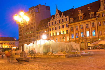 rynek: Beautiful city landscape with a lantern and fountain on the medieval Market square in Wroclaw (capital of Silesia), Poland, Europe in the evening