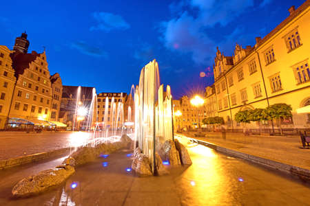 rynek: fabulous city landscape with fountain on the medieval Market square in Wroclaw (capital of Silesia), Poland, Europe in the evening Stock Photo
