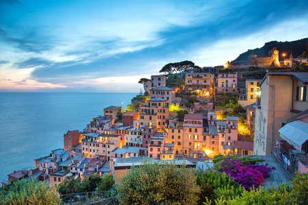 city park boat house: fabulous romantic landscape in Riomaggiore on the evening in Cinque Terre, Liguria, Italy, Europe.