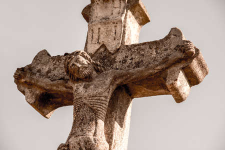Ancient stone crucifix. Vintage style. Stock Photo