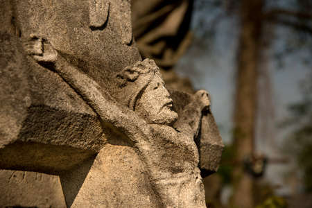 Stone crucifixion on the old cemetery. Stock Photo