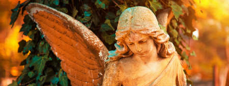The figure of an angel in a golden glow. Symbol of love, invisible forces, purity, enlightenment, ministry. Chariot. Place for the inscription. Archivio Fotografico