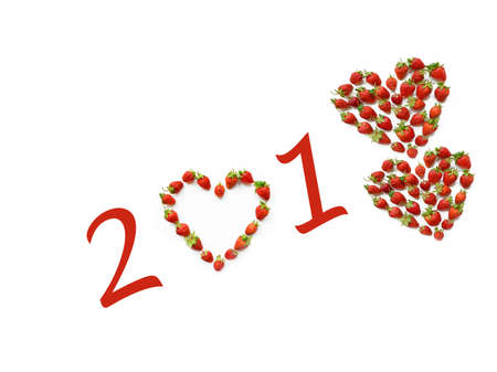 romantic Christmas motif with heart shaped strawberries (2018, New Year card - concept). Stock Photo