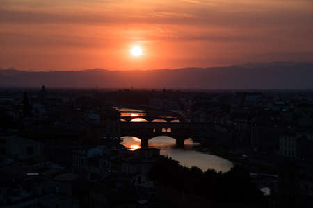 Famous bridges over the Arno river in Florence, Italy, at the dawn of the sun. Fantastic romantic landscape.