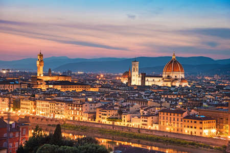 A fabulous panoramic view of Florence from Michelangelo Square in the evening lights. It is a pilgrimage of tourists and romantics. Duomo Cathedral. Italy, Tuscany Stock Photo