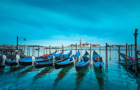 Mystical landscape with gondolas on the Grand Canal on the background of  Church of San Giorgio Maggiore in Venice, Italy, Europe. Stock Photo