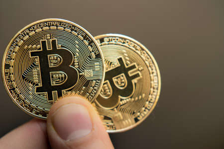 two bitcoins in hand (Investment, course change, rise, decline, luxury, success, stock exchange - concept)