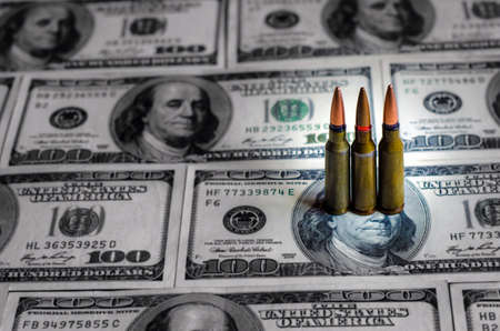 Bullets and banknotes as a symbol of military conflicts in the world Stock Photo