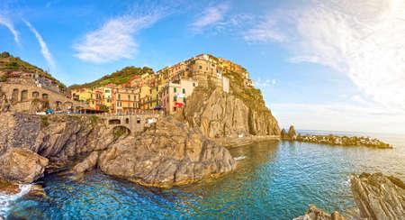 Beautiful colorful summer landscape-panorama on the coast of Manarola in Cinque Terre, Liguria, Italy, Europe in sunlight