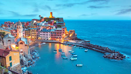 Magical landscape with boats in the bay and colored houses on the rock in Vernazza, Cinque Terre, Italy, Europe at night Reklamní fotografie