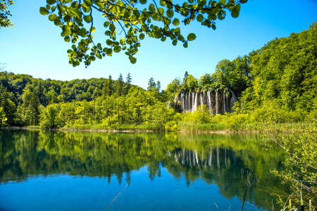 charming, fascinating landscape with a lake and a waterfall in the national park in Plitvice, Croatia. 版權商用圖片
