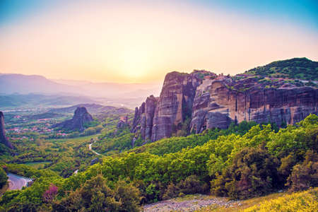 magnificent magical landscape in the famous valley of the Meteora rocks in Greece at sunset. Great amazing world. Attractions.