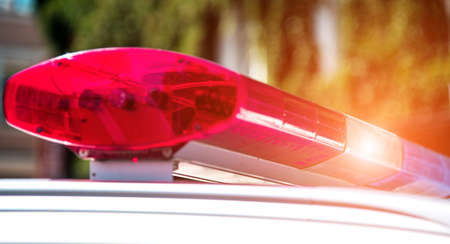 Signal lamp on the police car close-up. (Security, help, law - concept)