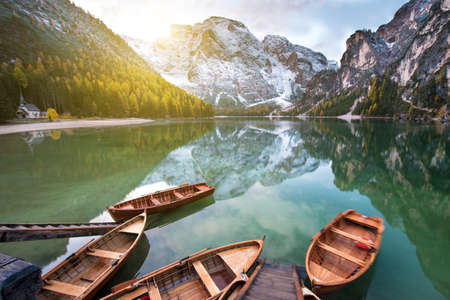 Magical beautiful fairy autumn landscape with boats on the lake on Fanes-Sennes-Braies natural park in the Dolomites in South Tyrol, Alps, Italy, Europe. (mental vacation, holiday, inner peace, harmony - concept) 版權商用圖片