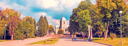 magical autumn landscape in the park with the oldest church in Ternopil, the Exaltation of the Holy Cross, Ukraine. Attractions. Tourist places of pilgrimage.