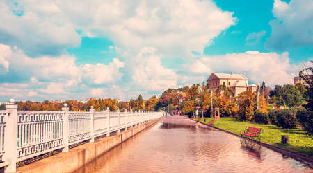 magical autumn landscape in the park with benches in the puddles on the promenade of Ternopil after heavy rain, Ukraine. amazing places. popular tourist atraction