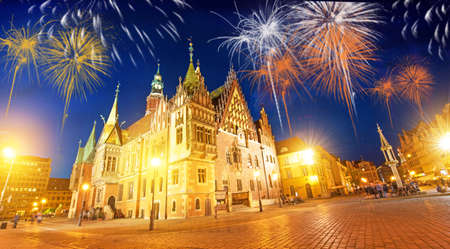 Beautiful bright colorful city landscape on the central square of Wroclaw, Poland in festive New Years fireworks 版權商用圖片