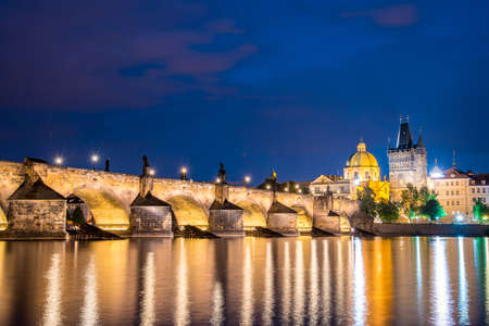 charming evening city landscape over the Vltava river in the old city of Prague, Czech Republic