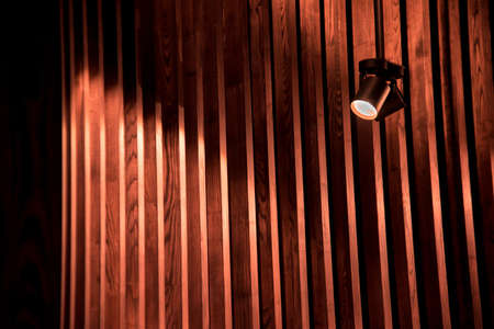 Abstraction image with a striped background of designer wooden rails and a lamp Stok Fotoğraf