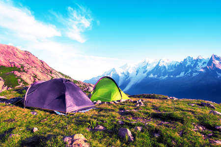 Two tents in the mountains in the Alps, Europe (still life coach, company, friendship, background - concept)