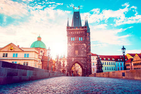 cute fascinating mystical landscape with arch-tower on Charles Bridge in an old city in Prague, Czech Republic at dawn. amazing places. popular tourist atraction