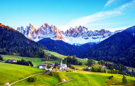 Magical spring landscape with a church in the valley of Santa Magdalena, Italy, Europe, Dolomites