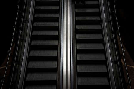 Abstract image of an escalator in the subway as a symbol of moving forward, getting out of depression, advancing and achieving life goals